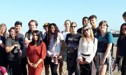 Young adult carers on beach