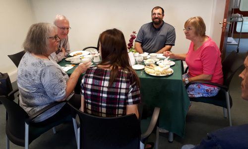 Group of peopple sitting around a table