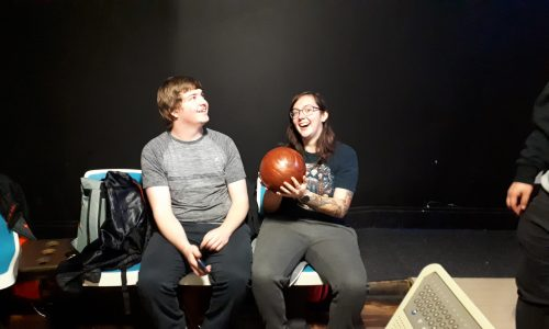 young people with bowling ball