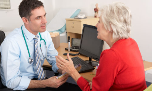 Dr talking to patient