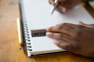 Hands with ruler and notebook