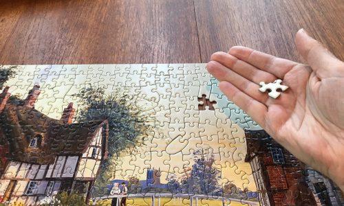 hand jigsaw puzzle