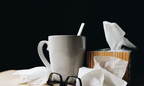 Cup, tissues and spectacles