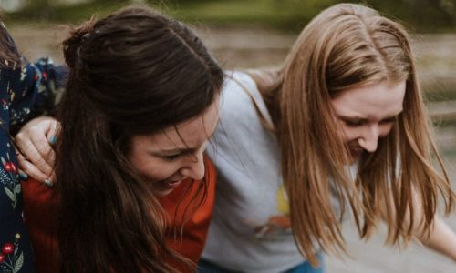 teenage girls laughing together