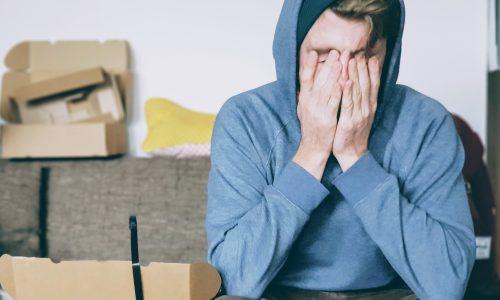 Stressed man on sofa