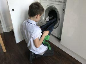 child emptying washing machine