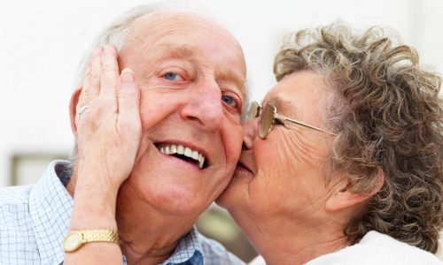 elderly couple kissing