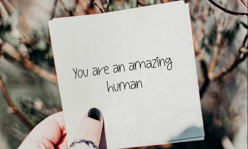 piece of paper with the words 'you are an amazing human' on it.