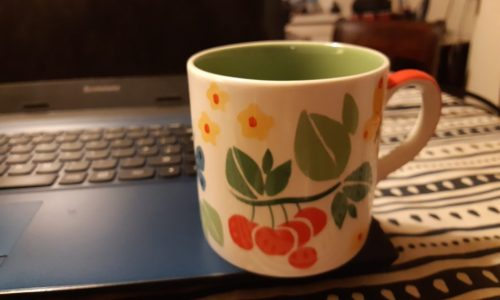 mug on laptop