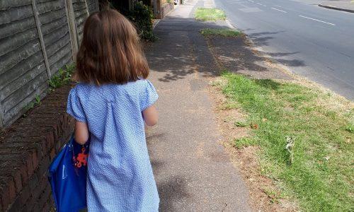 Child walking alone to school
