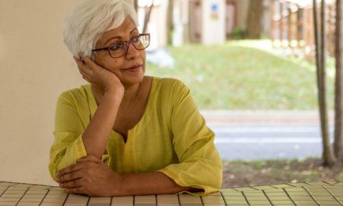 older woman sitting thinking