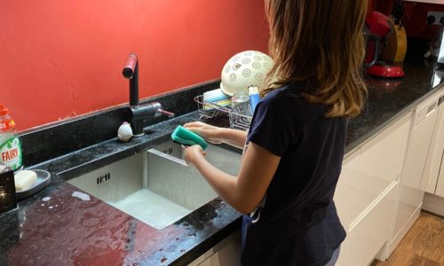 child doing dishes