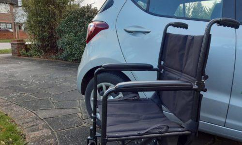 wheelchair next to car