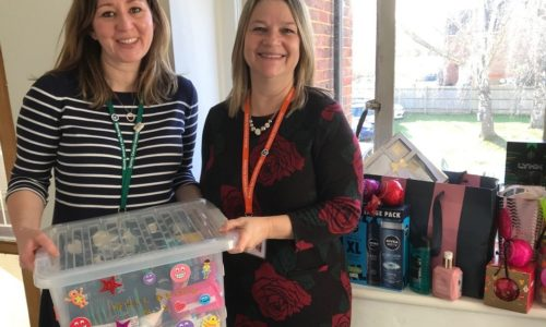 two women with box of donations