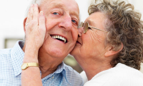 Happy-elderly-couple-embracing