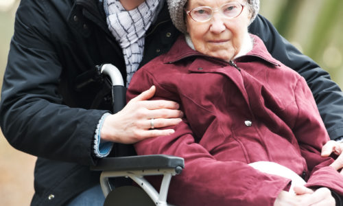 Man with older woman-in-wheelchair