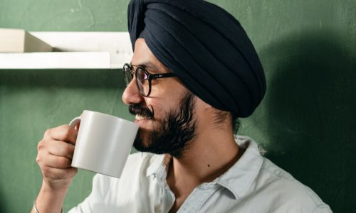 man in turban with mug