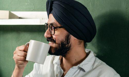 man in turban with mug