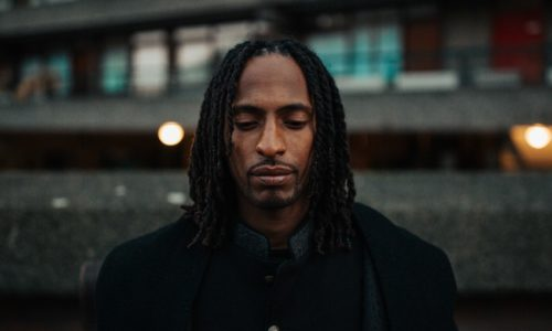 black-man-sad-city-setting