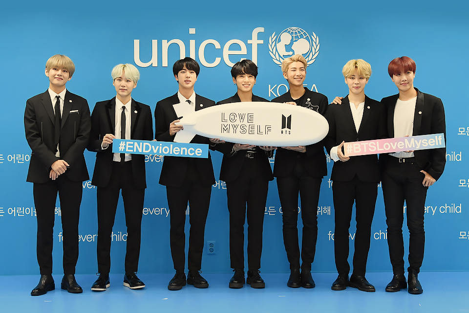 BTS holding love myself sign