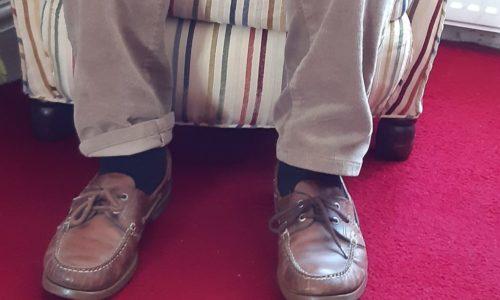 man's feet armchair