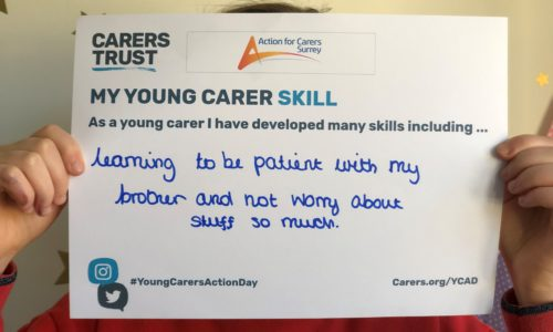 Young-carer-holds-skills-card