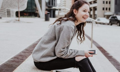 young woman on steps laughing