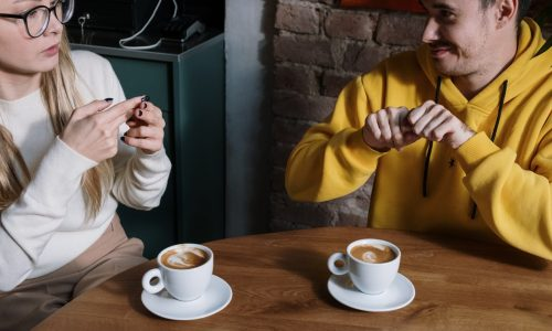 people-signing-chat-coffee
