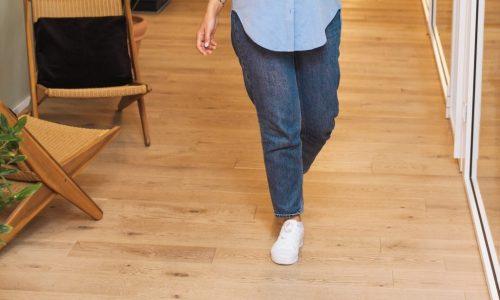 lower half of woman walking indoors