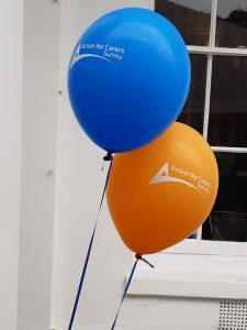 blue ballon and orange ballon with Action for Carers design
