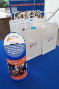 Action for Carers charity collection tin with gift bagswith