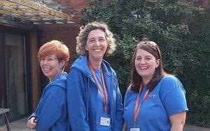 three women in blue Surrey Young Carers uniform