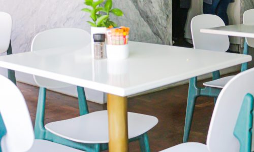 white cafe table and chairs