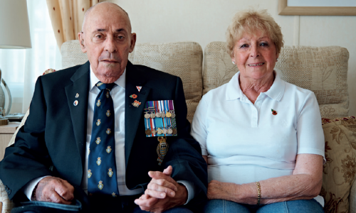 Armed forces couple on sofa