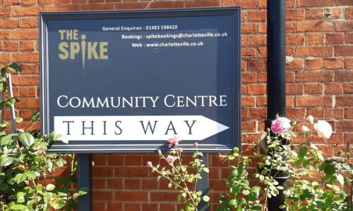 blue signboard for The Spike Community Centre