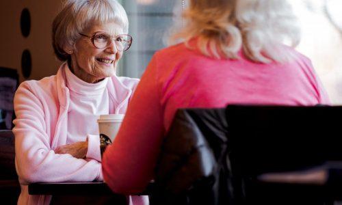 older women talking in cafe